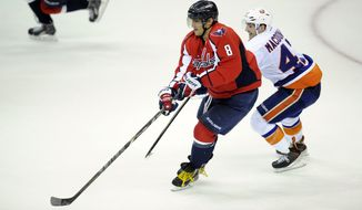 Washington Capitals right wing Alex Ovechkin (8), of Russia, skates with the puck against New York Islanders defenseman Andrew MacDonald (47) during the third period an NHL hockey game, Tuesday, Nov. 5, 2013, in Washington. The Capitals won 6-2. (AP Photo/Nick Wass)
