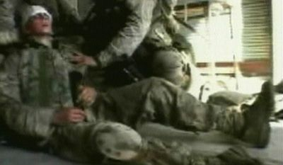 In this Tuesday, Nov. 9, 2004 image made from video, U.S. soldiers tend to an injured comrade as U.S. and Iraqi forces pushed their way into the center of the insurgent stronghold of Fallujah, Iraq, overwhelming small bands of guerrillas with massive force, searching homes along the city's deserted, narrow passageways and using loudspeakers to try to goad militants onto the streets. (AP Photo/APTN, Pool)