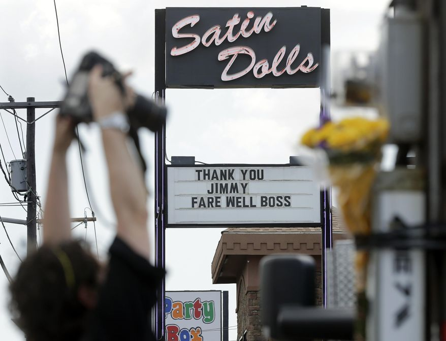 "FILE - This June 20, 2013 file photo shows the exterior of  Satin Dolls, in Lodi, N.J., the location for the Bada Bing Club on the HBO series ""The Sopranos."" The marquee offers a tribute to the late actor James Gandolfini, who portrayed mob boss Tony Soprano.  The site may be of interest to Super Bowl visitors who are also Sopranos fans. (AP Photo/Mel Evans, File)"