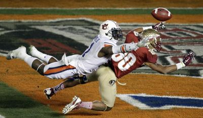 Auburn's Chris Davis is called for pass interference on a ball intended for Florida State's Rashad Greene during the second half of the NCAA BCS National Championship college football game Monday, Jan. 6, 2014, in Pasadena, Calif. (AP Photo/Gregory Bull)