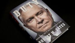 """The book entitled: """"Duty: Memoirs of a Secretary of War,"""" by former Defense Secretary Robert Gates is seen in Washington, Wednesday, Jan. 8, 2014. The White House is bristling over former Defense Secretary Robert Gates' new memoir accusing President Barack Obama of showing too little enthusiasm for the U.S. war mission in Afghanistan and sharply criticizing Vice President Joe Biden's foreign policy instincts. (AP Photo/Jacquelyn Martin)"""