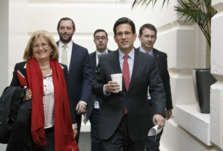 ** FILE** House Majority Leader Eric Cantor of Va., walks with Rep. Diane Black, R-Tenn., left, on their way to a Republican strategy meeting on Capitol Hill in Washington, Wednesday, Jan. 8, 2014. (AP Photo/J. Scott Applewhite)