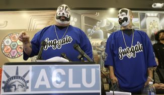 Joseph Bruce aka Violent J, left, and Joseph Utsler aka Shaggy 2 Dope, member of the Insane Clown Posse address the media in Detroit, Wednesday, Jan. 8, 2014. The rap metal group sued the U.S. Justice Department on Wednesday over a 2011 FBI report that describes the duo's devoted fans, the Juggalos, as a dangerous gang, saying the designation has tarnished their fans' reputations and hurt business. The American Civil Liberties Union filed the lawsuit in Detroit federal court on behalf of the group's two members. (AP Photo/Carlos Osorio)