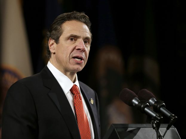 ** FILE ** New York Gov. Andrew Cuomo delivers his annual State of the State address at the Empire State Plaza Convention Center on Wednesday, Jan. 8, 2014, in Albany, N.Y. (AP Photo/Mike Groll)
