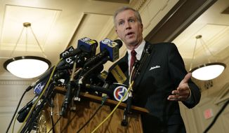 ** FILE ** New Jersey Assemblyman John S. Wisniewski, D-Sayreville, N.J., answers a question at the Statehouse in Trenton, N.J., Wednesday, Jan. 8, 2014, after a top aide to New Jersey Gov. Chris Christie was linked through emails and text messages to a seemingly deliberate plan to create traffic gridlock in a town at the base of the George Washington Bridge after its mayor refused to endorse Christie for re-election.  (AP Photo/Mel Evans)