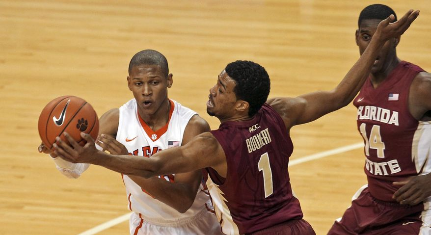 Florida State's Devon Bookert (1) gets a hand on the ball as Clemson's Jordan Roper looks to pass during the second half of an NCAA college basketball game at Littlejohn Coliseum in Clemson, S.C., on Thursday, Jan. 9, 2014. (AP Photo/Anderson Independent-Mail, Mark Crammer) GREENVILLE NEWS OUT   SENECA JOURNAL OUT