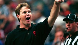 Orlando's head coach and former Storm quarterback Jay Gruden cheers while pointing up to the Orlando fan section during the closing minutes of an Orlando victory over the Tampa Bay Storm during the Arena Bowl XII at the Ice Palace in Tampa on Sunday (8/23/98). - -Photo By:Dirk Shadd/Tampa Bay Times