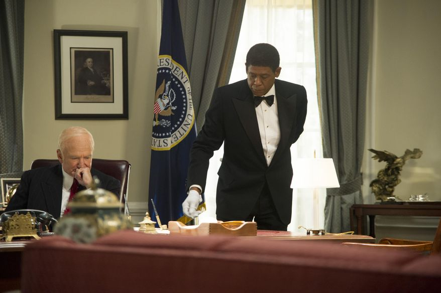 "This film image released by The Weinstein Company shows Robin Williams as Dwight Eisenhower, left, and Forest Whitaker as Cecil Gaines in a scene from ""Lee Daniels' The Butler."" The film was nominated for an Image Award for best motion picture on Thursday, Jan. 9, 2014.  The 45th NAACP Image Awards will be held on Feb. 22. (AP Photo/The Weinstein Company, Anne Marie Fox)"