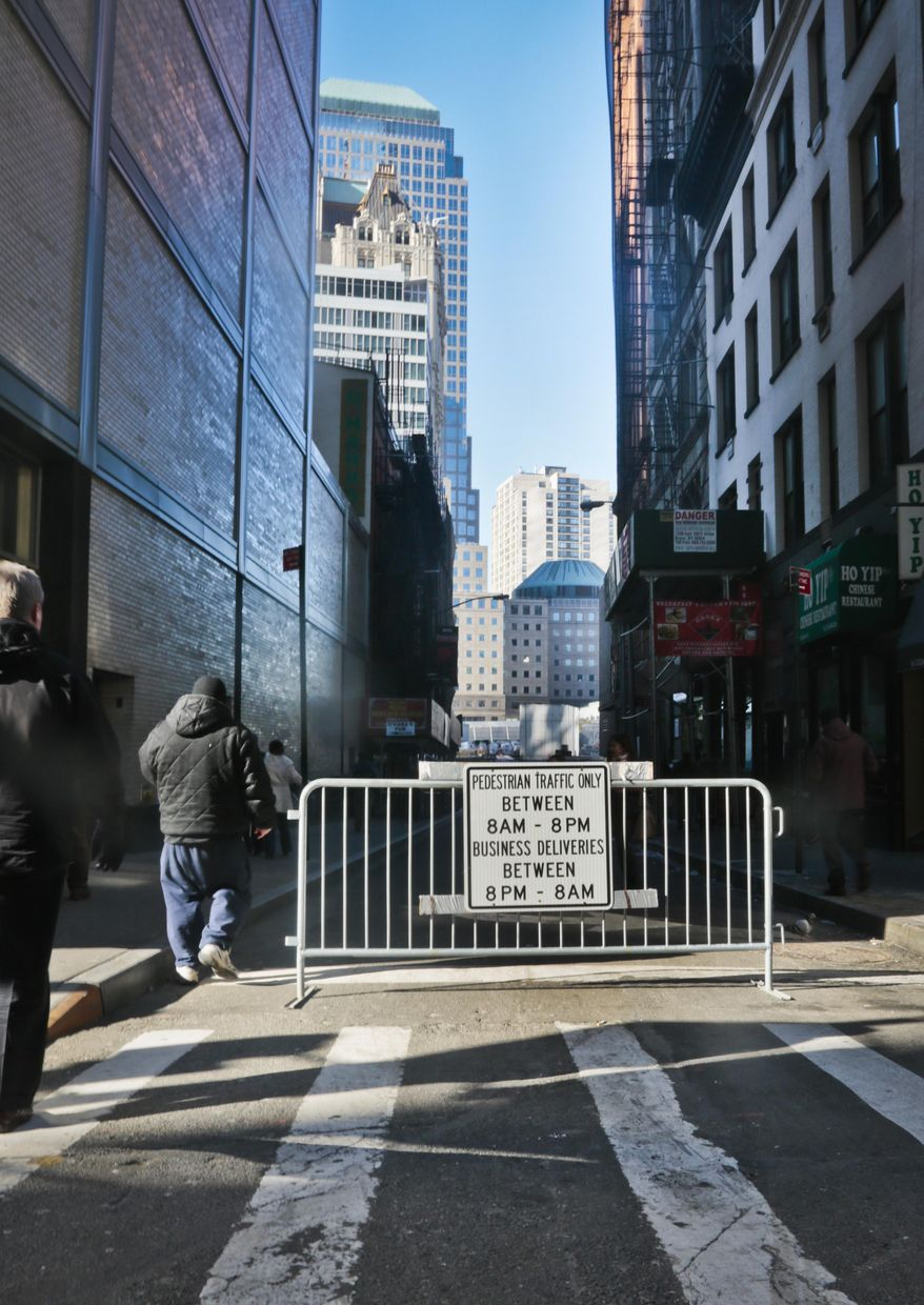 A barricade blocks a multi zone residential and commercial street, permitting limited vehicle access on Thursday, Jan. 9, 2014 in New York. Area residents living in the the shadow of the World Trade center have filed a lawsuit against city plans to build a security perimeter around her neighborhood, they say would permanently restrict street access, create congestion and health hazards, among their concerns.  (AP Photo/Bebeto Matthews)