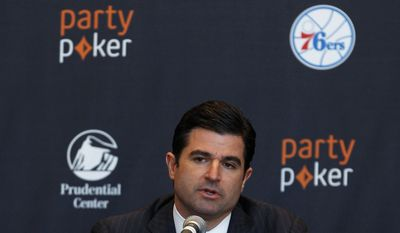 Scott O'Neil, chief executive of the New Jersey Devils, the Prudential Center and the Philadelphia 76ers, speaks during a news conference announcing a deal naming partypoker as the official online gaming partner of the 76ers, the Devils and the Prudential Center on Thursday, Jan. 9, 2014, in Newark, N.J. (AP Photo/Adam Hunger)