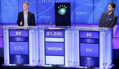 "FILE - In this file photo of  Jan. 13, 2011, ""Jeopardy!"" champions Ken Jennings, left, and Brad Rutter, right, look on as the IBM computer called ""Watson"" beats them to the buzzer to answer a question during a practice round of the ""Jeopardy!"" quiz show in Yorktown Heights, N.Y. IBM announced Thursday, Jan. 9, 2014  that it's investing over $1 billion to give its Watson cloud computing system its own business division and a new home in the heart of New York City  (AP Photo/Seth Wenig, File)"