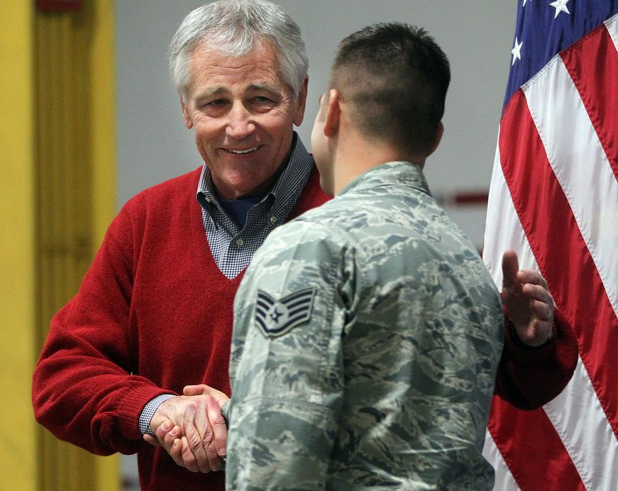 Defense Secretary Chuck Hagel greets an airman from the 20th Air Force 90th Missile Wing during a trip to F.E. Warren Air Force Base on Thursday, Jan. 9, 2014 in Cheyenne, Wyo. It was the first time since 1982 that a defense secretary has visited the nuclear missile base. (AP Photo/Wyoming Tribune Eagle, Blaine McCartney)