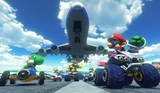 "This photo provided by Nintendo shows a scene from the video game, ""Mario Kart 8."" (AP Photo/Nintendo)"