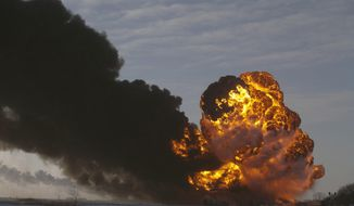 "FILE - In this Dec. 30, 2013 file photo, a fireball goes up at the site of an oil train derailment in Casselton, N.D. Former North Dakota governor and Casselton native George Sinner wants new regulations placed upon railroads that transport crude oil from the state. Sinner says the derailment of tanker cars and ensuing fire outside Casselton shows what he calls a ""ridiculous threat"" to communities across the United States. (AP Photo/Bruce Crummy, File)"