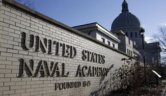 A sign stands outside of an entrance to the U.S. Naval Academy campus in Annapolis, Md., on Jan. 9, 2014. A culture of bad behavior and disrespect among athletes at U.S. military academies is one part of the continuing problem of sexual assaults at the schools, according to a new Defense Department report that comes in the wake of scandals that rocked teams at all three academies last year. (Associated Press) **FILE**