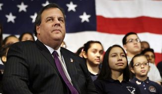 ** FILE ** In this Jan. 7, 2014, file photo, New Jersey Gov. Chris Christie sits with students during a gathering at Colin Powell elementary school in heavily Hispanic Union City, N.J. after he ceremonially signed a bill that lowers tuition costs at public colleges for New Jersey students who lack lawful immigration status. A day after revelations that Christie's administration may have closed highway lanes to exact political retribution, the prospective Republican presidential candidate is faced with what may be the biggest test in his political career. (AP Photo/Mel Evans, File)