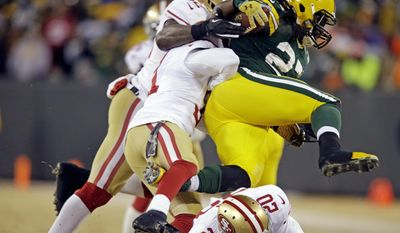 Green Bay Packers running back Eddie Lacy (27) leaps over San Francisco 49ers defensive back Perrish Cox (20) as he runs against the 49ers defense during the first half of an NFL wild-card playoff football game, Sunday, Jan. 5, 2014, in Green Bay, Wis. (AP Photo/Jeffrey Phelps)