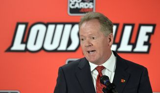 New Louisville head football coach Bobby Petrino address reporters following the announcement of his hiring Thursday, Jan. 9, 2014 at Papa John's Cardinal Stadium in Louisville, Ky. (AP Photo/Timothy D. Easley)