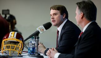 Washington Redskins Executive Vice President and General Manager Bruce Allen, right, introduces former Cincinnati Bengals offensive coordinator Jay Gruden, left, as the new head coach of the Washington Redskins at a press conference at Redskins Park, Ashburn, Va., Thursday, January 9, 2014. (Andrew Harnik/The Washington Times)