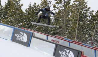 Shaun White goes for the rail slide on his first qualifying run at  the U.S. Grand Prix freestyle event at Breckenridge, Colo., Thursday, Jan. 9, 2014. (AP Photo/Summit Daily News, Sebastian Fritz)
