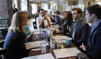 President Barack Obama listens as he has lunch with five young people at The Coupe restaurant in the Columbia Heights section of Washington, Friday, Jan. 10, 2014. The five are spearheading creative outreach efforts to connect with and help enroll young consumers through the Marketplaces or are interested in getting more involved with these efforts. Seated at the table with Obama are, from left, Anne Johnson, Andres Cruz, Obama, Jasmine Hicks, Tommy McFly and David Dimock. (AP Photo/Susan Walsh)