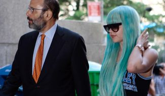 In this Tuesday, July 9, 2013, file photo, Amanda Bynes, accompanied by attorney Gerald Shargel, arrives for a court appearance in New York on allegations that she chucked a marijuana bong out the window of her 36th-floor Manhattan apartment. (AP Photo/Bethan McKernan, File)