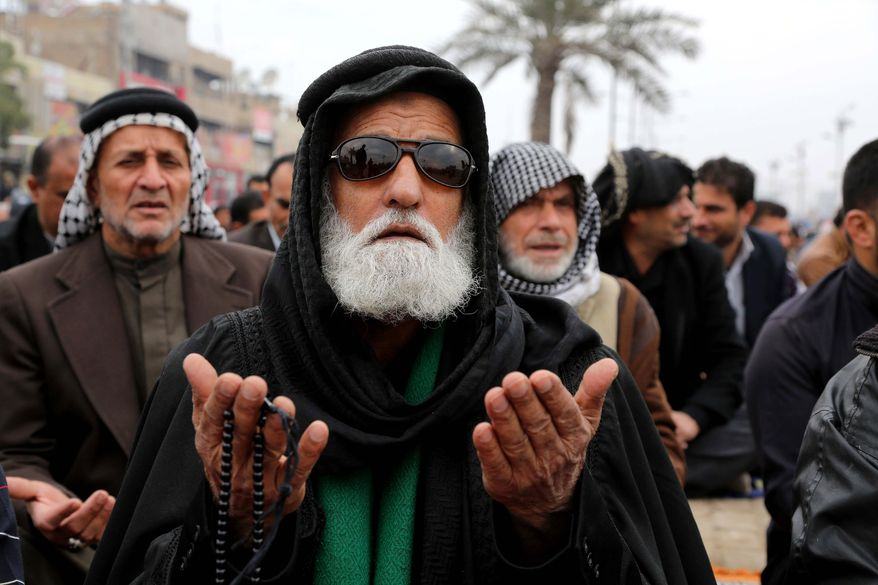 Followers of Shiite cleric Muqtada al-Sadr crowd a street as they attend open air Friday prayers in the Shiite stronghold of Sadr City in Baghdad, Iraq, Friday, Jan. 10, 2014. (AP Photo/Karim Kadim)