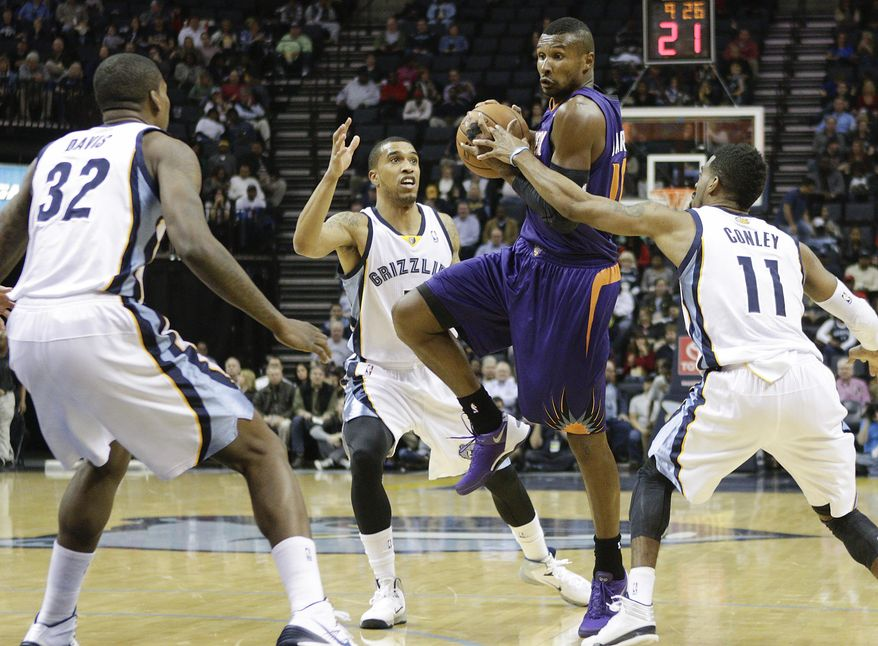 Phoenix Suns guard Leandro Barbosa, second from right, of Brazil, shoots against Memphis Grizzlies forward Ed Davis (32), guard Courtney Lee and guard Mike Conley (11) in the first half of an NBA basketball game, Friday, Jan. 10, 2014, in Memphis, Tenn. (AP Photo/Lance Murphey)