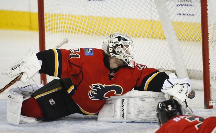 Calgary Flames goalie Karri Ramo, from Finland, lets in a goal during third period NHL hockey action against the St. Louis Blues in Calgary, Alta., Thursday, Jan. 9, 2014. The St. Louis Blues beat the Calgary Flames 5-0. (AP Photo/The Canadian Press, Jeff McIntosh)