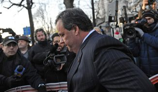 "New Jersey Gov. Chris Christie walks past reporters as he leaves City Hall Thursday, Jan. 9, 2014, in Fort Lee, N.J. Christie traveled to Fort Lee to apologize in person to Mayor Mark Sokolich. Moving quickly to contain a widening political scandal, Gov. Chris Christie fired one of his top aides Thursday and apologized repeatedly for the ""abject stupidity"" of his staff, insisting he had no idea anyone around him had engineered traffic jams to get even with a Democratic mayor. (AP Photo/Louis Lanzano)"