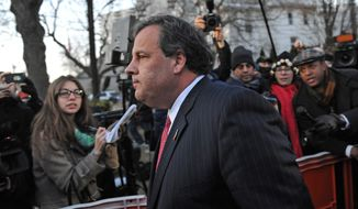 ** FILE ** In this Thursday, Jan. 9, 2014, file photo, New Jersey Gov. Chris Christie walks past reporters as he leaves City Hall, in Fort Lee, N.J., after apologizing in person to Mayor Mark Sokolich. (AP Photo/Louis Lanzano, File)