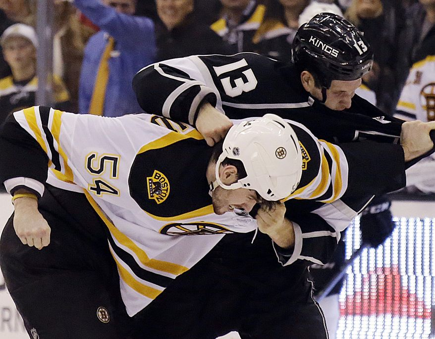 Los Angeles Kings left winger Kyle Clifford (13) and Boston Bruins defenseman Adam McQuaid (54) fight in the second period of an NHL hockey game in Los Angeles Thursday, Jan. 9, 2014. (AP Photo/Reed Saxon)
