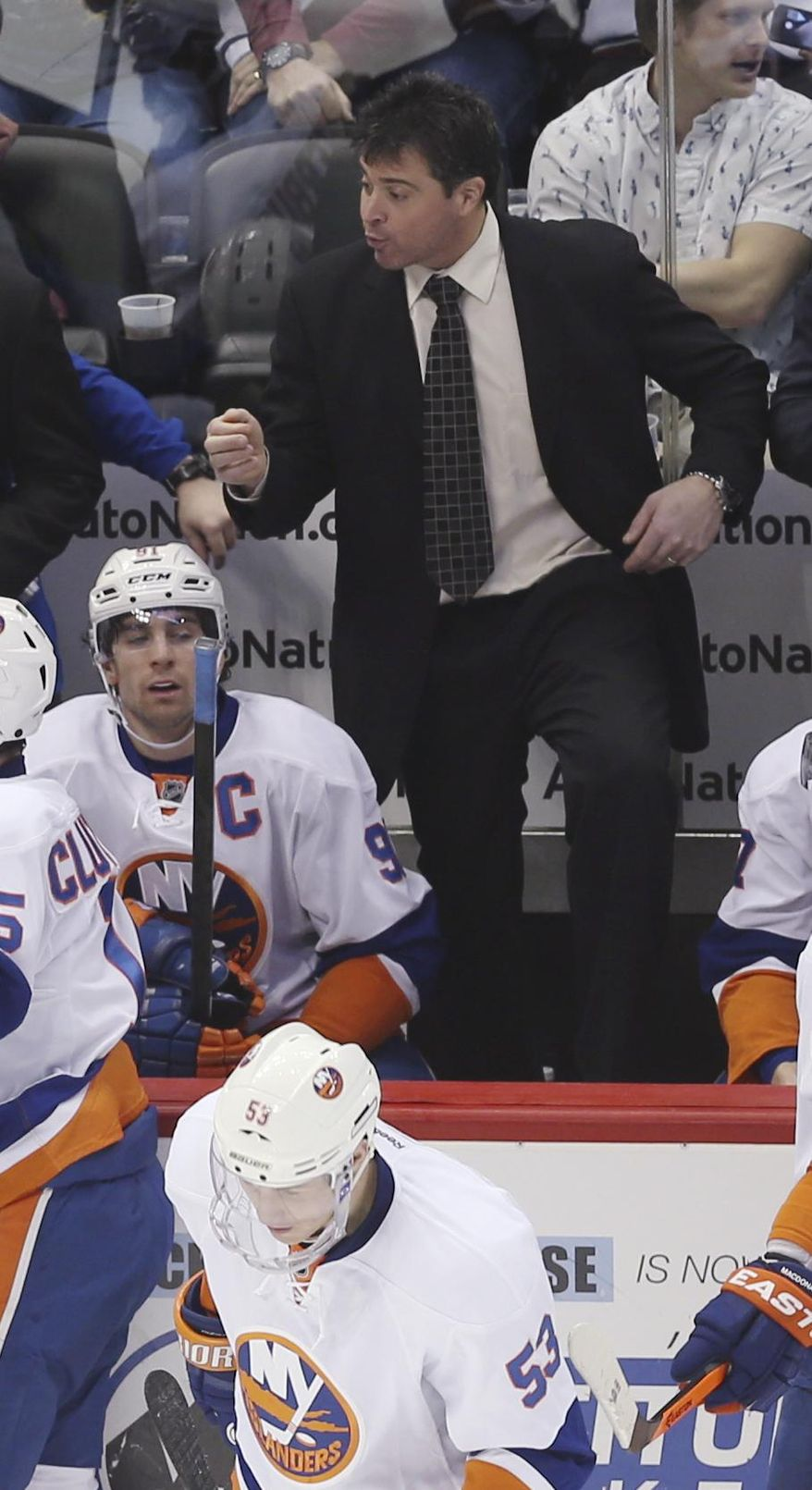 New York Islanders coach Jack Capuano argues a call against his team while facing the Colorado Avalanche in the second period of an NHL hockey game in Denver on Friday, Jan. 10, 2014. (AP Photo/David Zalubowski)