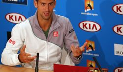 Novak Djokovic of Serbia sits next to boxes of chocolate before handing out reporters during a press conference, ahead of the Australian Open tennis championship in Melbourne, Australia, Sunday, Jan. 12, 2014. (AP Photo/Shuji Kajiyama)