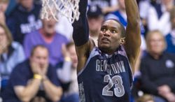 Georgetown's Aaron Bowen (23) goes to the basket for a slam dunk in overtime of an NCAA college basketball game, Saturday, Jan. 11, 2014, in Indianapolis. Georgetown defeated Butler 70-67 in overtime. (AP Photo/Doug McSchooler)