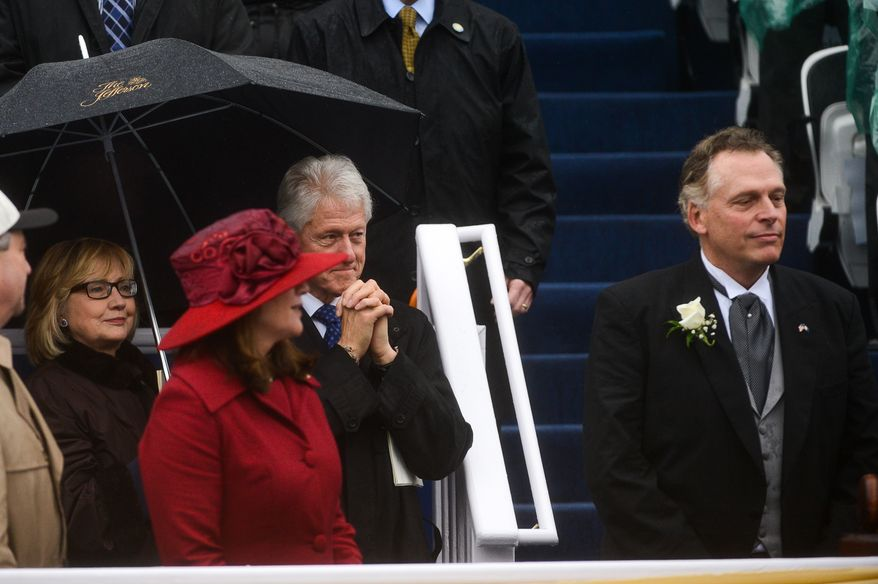 Former U.S. President Bill Clinton and Hilary Clinton watch as newly sworn in Virginia Gov. Terry McAuliffe, right, prepares to give a speech after being becoming the 72nd Governor of the Commonwealth of Virginia in front of the Virginia State Capitol, Richmond, Va., Saturday, January 11, 2014. (Andrew Harnik/The Washington Times)