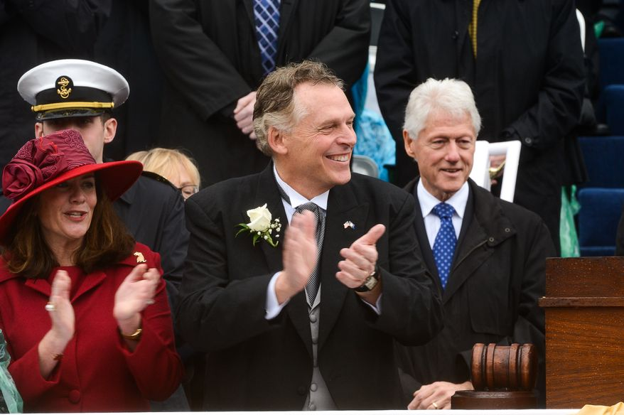 Former U.S. President Bill Clinton, right, stands in attendance as newly sworn in Virginia Gov. Terry McAuliffe, center, and his wife, Dorothy, left, clap together after McAuliffe becomes the 72nd Governor of the Commonwealth of Virginia in front of the Virginia State Capitol, Richmond, Va., Saturday, January 11, 2014. (Andrew Harnik/The Washington Times)
