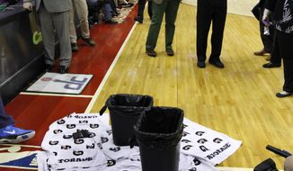 Towels and trash cans are used to catch water dripping from the ceiling in the first half of an NBA basketball game between the Houston Rockets and the Washington Wizards, Saturday, Jan. 11, 2014, in Washington. (AP Photo/Alex Brandon)