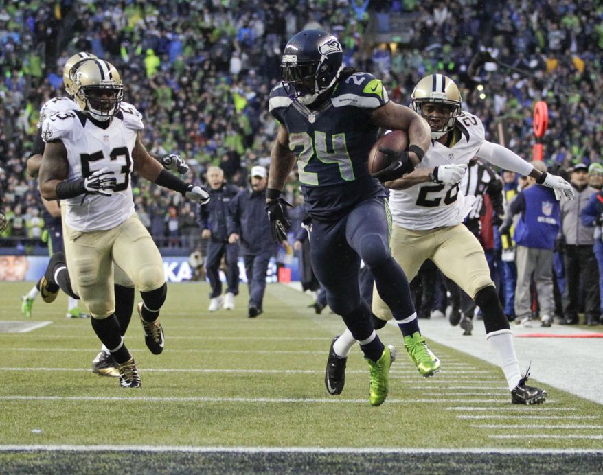Seattle Seahawks running back Marshawn Lynch (24) runs past New Orleans Saints cornerback Keenan Lewis (28) and outside linebacker Ramon Humber (53) to score a 31-yard touchdown during the fourth quarter of an NFC divisional playoff NFL football game in Seattle, Saturday, Jan. 11, 2014. (AP Photo/John Froschauer)