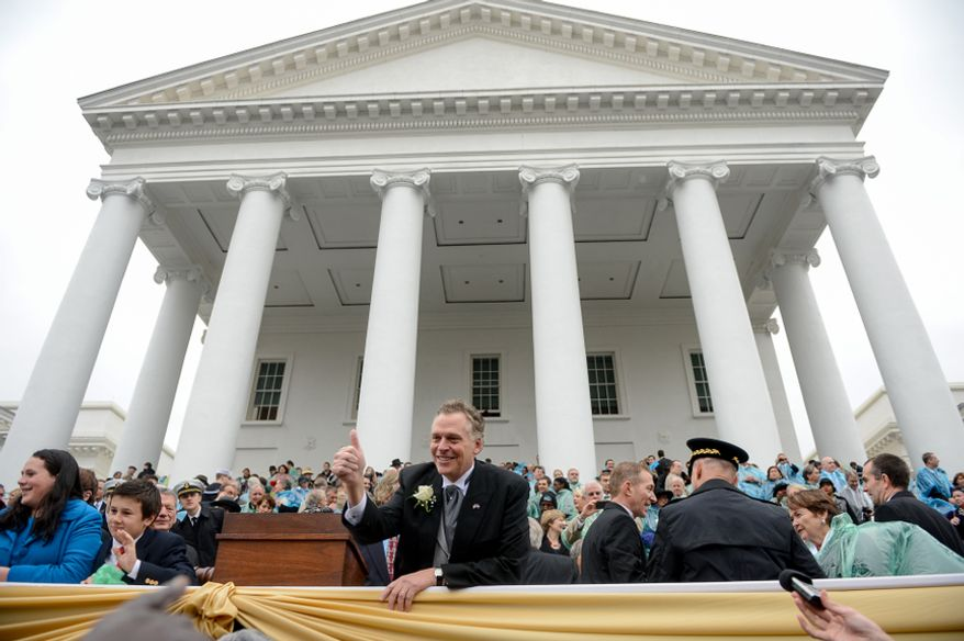 Sworn in Virginia Gov. Terry McAuliffe waves and speaks to supporters after being becoming the 72nd Governor of the Commonwealth of Virginia in front of the Virginia State Capitol, Richmond, Va., Saturday, January 11, 2014. (Andrew Harnik/The Washington Times)