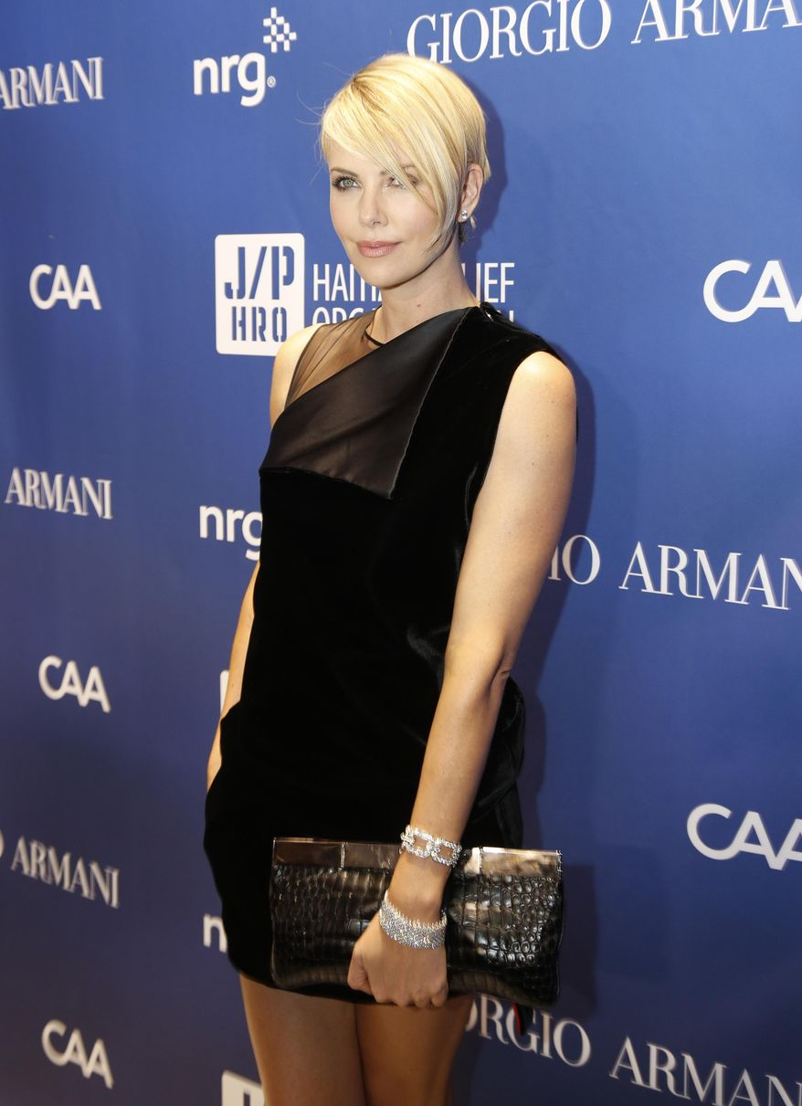Charlize Theron arrives at the 3rd Annual Sean Penn & Friends HELP HAITI HOME Gala on Saturday, Jan. 11, 2014 at the Montage Hotel in Beverly Hills, Calif. (Photo by Colin Young-Wolff /Invision/AP)