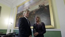 Outgoing Virginia Gov. Bob McDonnell and his wife, Maureen,  wait in the old Senate Chambers prior to the inauguration of Virginia Governor Terry McAuliffe at the Capitol in Richmond, Va., Saturday, Jan. 11, 2014. McAuliffe was sworn in as the 72nd Governor of Virginia.  (AP Photo/Steve Helber)