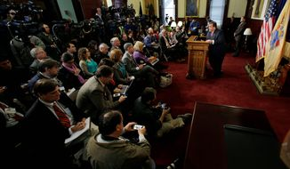 New Jersey Gov. Chris Christie answers questions during a news conference on Thursday to address the bridge scandal. Republicans came to Mr. Christie's defense, praising his willingness to take responsibility for the incident and to hold those at fault accountable for their actions. (Associated Press photographs)