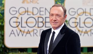 Kevin Spacey arrives at the 71st annual Golden Globe Awards at the Beverly Hilton Hotel on Sunday, Jan. 12, 2014, in Beverly Hills, Calif. (Photo by John Shearer/Invision/AP)