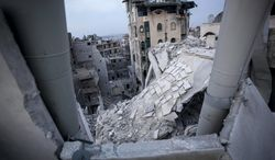 ** FILE ** In this Thursday, Nov. 29, 2012, file photo, destroyed buildings, including the Dar Al-Shifa hospital, bottom, lay in ruins following airstrikes in Aleppo, Syria. (AP Photo/Narciso Contreras, File)