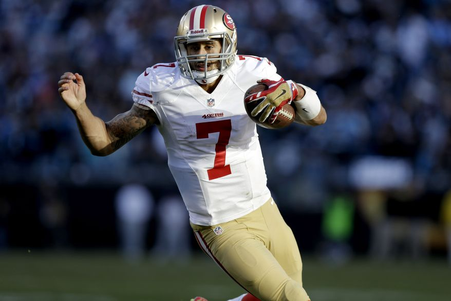 San Francisco 49ers quarterback Colin Kaepernick (7) carries the ball against the Carolina Panthers during the second half of a divisional playoff NFL football game, Sunday, Jan. 12, 2014, in Charlotte, N.C. (AP Photo/Gerry Broome)