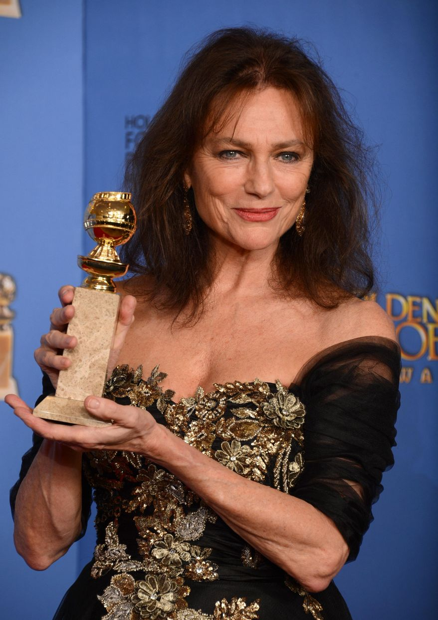 "Jacqueline Bisset poses in the press room with the award for best supporting actress in a series, mini-series or motion picture made for television for ""Dancing on the Edge"" at the 71st annual Golden Globe Awards at the Beverly Hilton Hotel on Sunday, Jan. 12, 2014, in Beverly Hills, Calif. (Photo by Jordan Strauss/Invision/AP)"