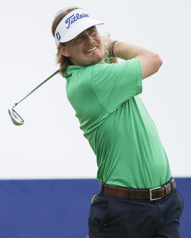 John Peterson watches his drive off the 17th tee during the third round of the Sony Open golf tournament at Waialae Country Club, Saturday, Jan. 11, 2014, in Honolulu. (AP Photo/Eugene Tanner)
