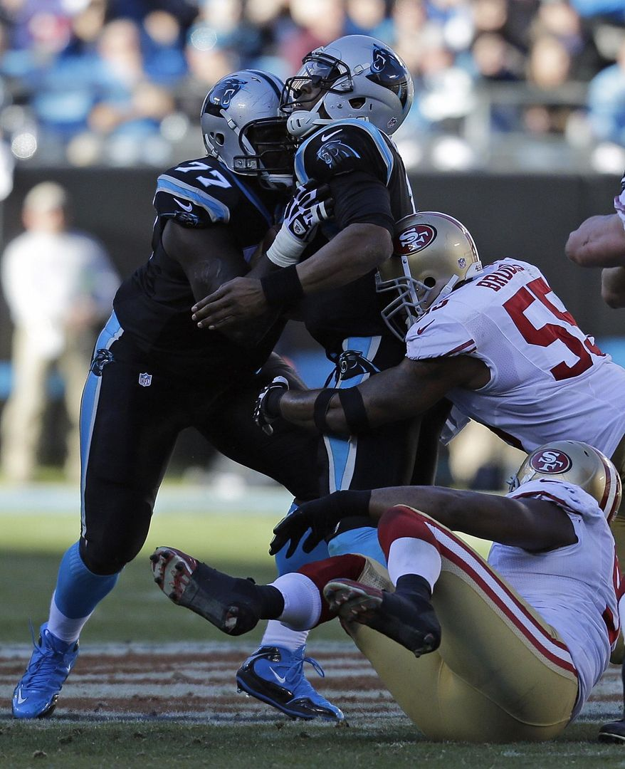 Carolina Panthers quarterback Cam Newton (1) runs into Carolina Panthers tackle Byron Bell (77) as San Francisco 49ers outside linebacker Ahmad Brooks (55) makes the sack during the second half of a divisional playoff NFL football game, Sunday, Jan. 12, 2014, in Charlotte, N.C. (AP Photo/Chuck Burton)