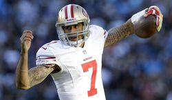 San Francisco 49ers quarterback Colin Kaepernick (7) runs against the Carolina Panthers during the second half of a divisional playoff NFL football game, Sunday, Jan. 12, 2014, in Charlotte, N.C. (AP Photo/Gerry Broome)